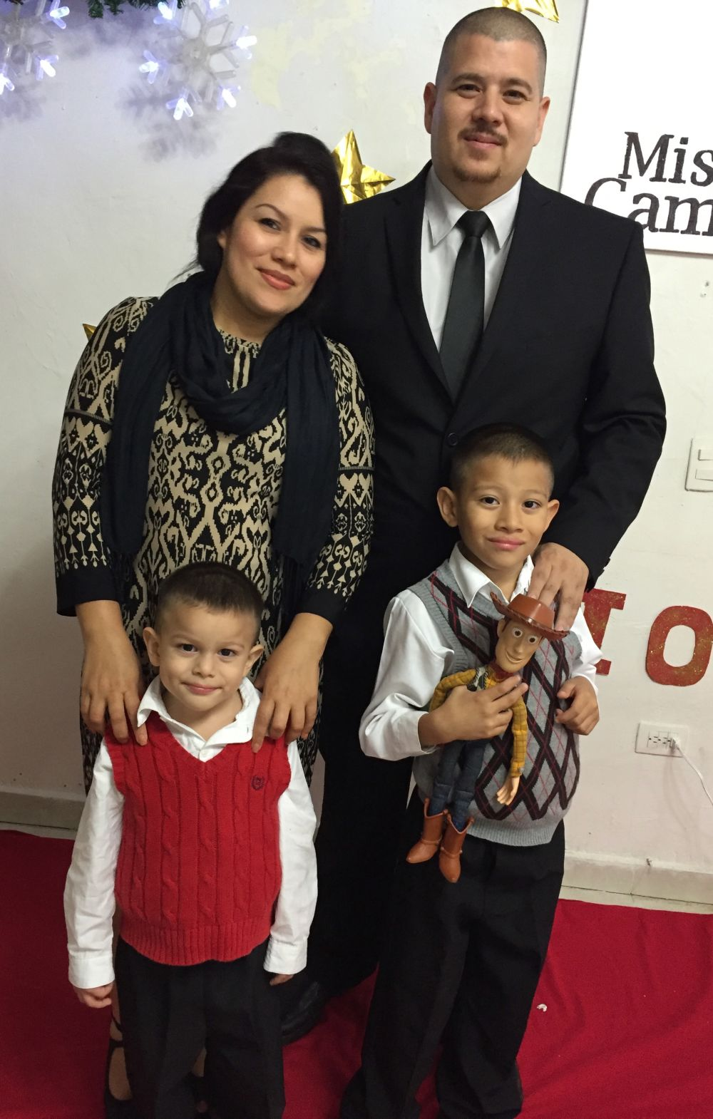 Robert Gonzalez Medina with his wife and two sons at a communion service in December 2016.