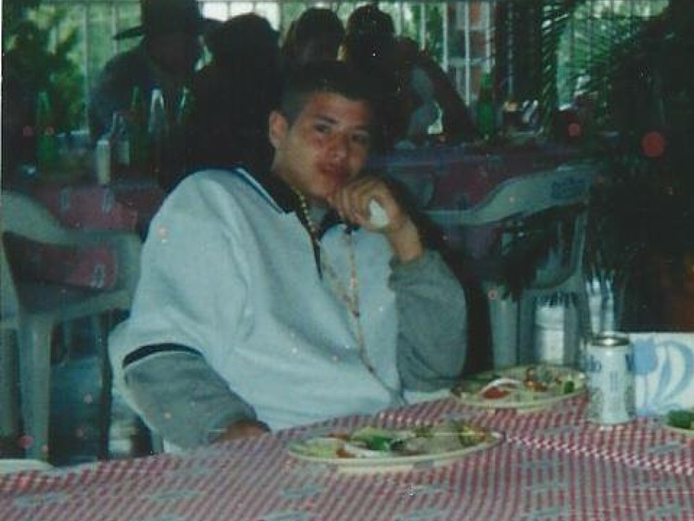 Robert Gonzalez Medina drinking a beer in a Los Angeles restaurant at the age of 15.