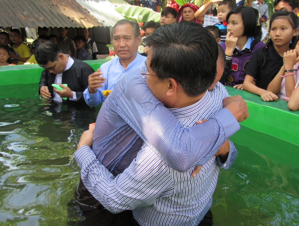 "Samuel choked up as he remembered his father emerging from the water of the baptismal tank and wrapping his arms around him.  ""It was the first time that he hugged me in my whole life,"" he said. (Family photo)"