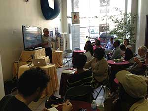 "Dr. Miroslav Pujic presents at the ""Connect to Escape"" lunch seminar in Manhattan. [photos by Jo Jo Man]"