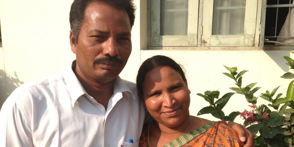 Elisha Athota embracing his wife, Solomi, on the compound of the Adventist Church's South Andhra Section in Ibrahimpatnam in central India.