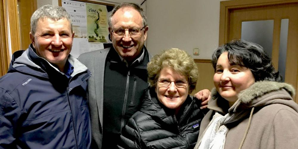 Ilie, left, and his wife, Lydia, visiting with AWR president Duane McKey and his wife, Kathy, in Pitesti, Romania. (Courtesy of Duane McKey)