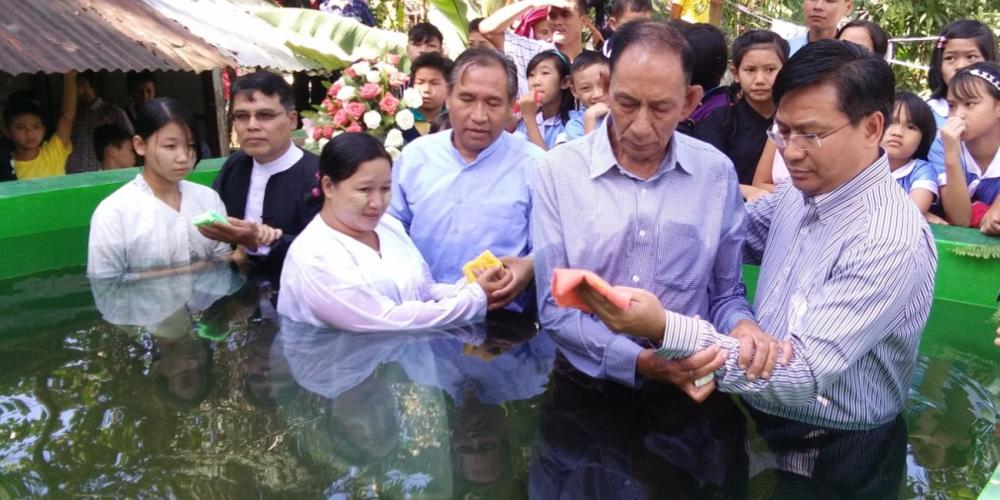"Samuel Saw, right, president of the Southern Asia-Pacific Division, baptizing his father. ""I was privileged to baptized my own father at the age of 76,"" Samuel says. (Family photo)"