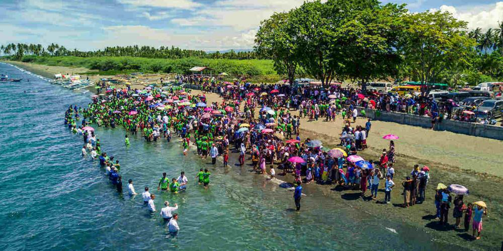 People being baptized on Mindoro Island in the Philippines on June 24, 2017. About 1,400 people were baptized after evangelistic meetings, which precede a countrywide campaign in 2018. (Nick Knecht / AWR)