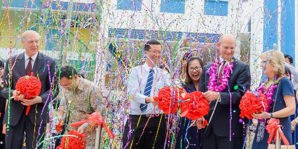 Ted N.C. Wilson, second right, and his wife, Nancy, right, cutting the red ribbon at the rededication of San Yu Adventist School in Singapore on Nov. 2, 2017. Also pictured are Johnny Kan, president of the Singapore Conference, third left; school principal Shee Soon Chiew, second left; and Jannie Bekker, assistant to the president of the Southeast Asia Union Mission, left. (Singapore Conference)