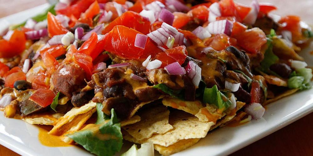 "Among the items on the Olive Branch menu is the Haystack, described as ""organic corn chips, chili, cheez sauce, lettuce, tomato, red onion, served with salsa, guacamole, and house spread."" (lewistonark.com)"