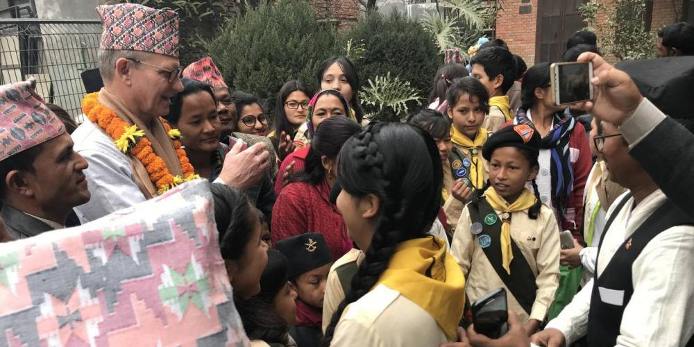 Adventist Church president Ted Wilson meeting Pathfinders and others outside Banepa church in Kathmandu, Nepal, on Feb. 12, 2018. (Andrew McChesney / Adventist Mission)