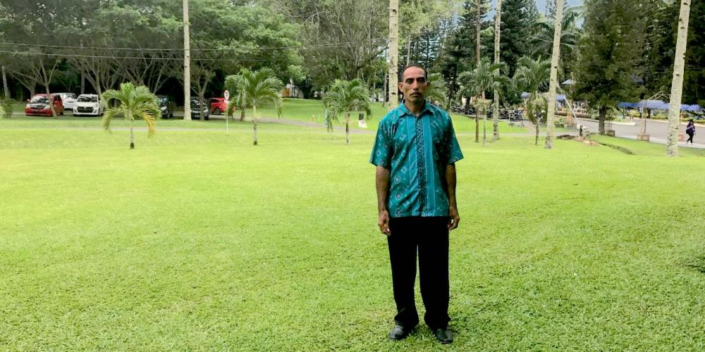 Petrus Tobolu meeting with Adventist Mission on the campus of Universitas Klabat, near Manado on Indonesia's Sulawesi island. (Andrew McChesney / Adventist Mission)