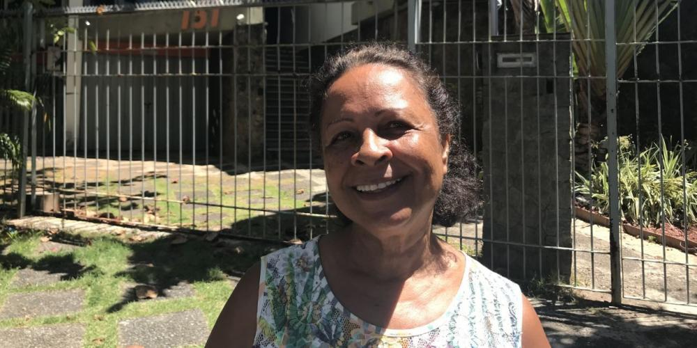 Maria Jose de Oliveira Palmeir standing outside the Sharing Jesus house church in Salvador, Brazil. (Andrew McChesney / Adventist Mission)