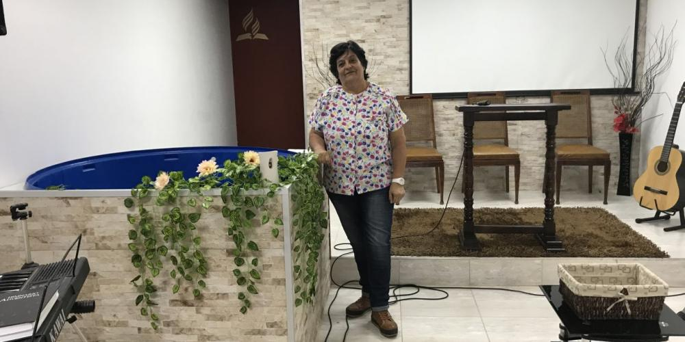 Maria Cecilia Freire, 60, standing beside the baptismal pool where she was baptized at Goes Seventh-day Adventist Church in Montevideo, Uruguay. (Andrew McChesney / Adventist Mission)