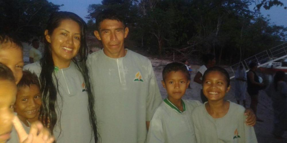 Cibele Desidere Pontes posing with her father at her baptism in the Amazon River. (Adventist Mission)
