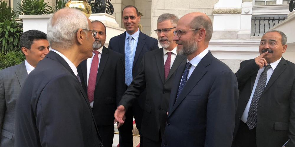 Adventist Church president Ted N.C. Wilson, second right, speaking with an Egyptian deputy foreign minister, foreground left, outside a government palace in Cairo, Egypt, after talks with Prime Minister Mostafa Madbouly on July 31, 2018. Also pictured are Youssry Youssif, right, government liaison and communication director for the Egypt-Sudan Field; Rick McEdward, third right, president of the Middle East and North Africa Union; Kheir Boutros, fourth right, associate treasurer of the Middle East and North Africa Union; Akram Khan, fifth right, treasurer of the Egypt-Sudan Field; and Johnny N. Salib, left, secretary of the Egypt-Sudan Field. (Myron Iseminger / Egypt-Sudan Field)
