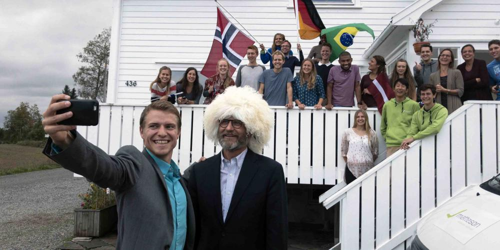 Jeremy Zwiker, left, chairman of the foundation that runs Matteson Mission School, taking a selfie with Adventist Church president Ted N.C. Wilson outside the school in Mysen, Norway, on Sept. 7, 2018. While meeting with the students, Wilson showed them a papakha, a wool hat worn by men in the Caucasus, that he received as a gift while visiting southern Russia shortly before arriving in Norway. (Andrew McChesney / Adventist Mission)
