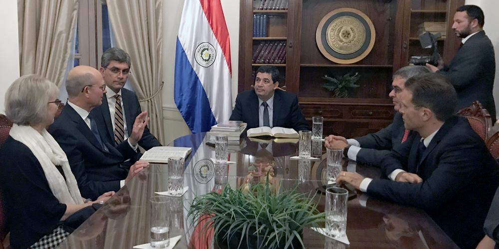 Paraguayan Vice President Hugo Velázquez Moreno, center, meeting with Adventist Church president Ted N.C. Wilson, second left, and other church delegates in his government office in Asunción, Paraguay, on April 22, 2019. Also in the photo are, from left, Wilson's wife, Nancy; Magdiel Pérez Schulz, assistant to the General Conference president; Erton Köhler, president of the South American Division; and Evandro C. Favero, president of the Adventist Church in Paraguay. (Pastor Ted Wilson / Facebook)