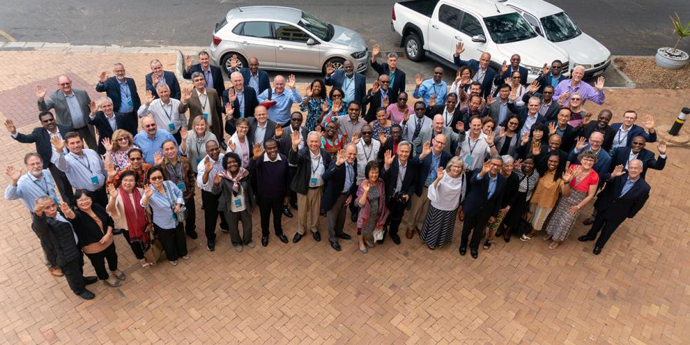 Seventh-day Adventist world church leaders and their spouses waving for a group photo at the 13th Global Leadership Summit in Cape Town, South Africa, on Feb. 5, 2020. (Otieno Mkandawire / SID)